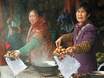 Sellers of roasted chestnuts Royalty Free Stock Photos