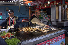 Sellers of sandwiches fish at Istanbul. Sellers of fresh fish to Galata bridge at Istanbul in Turkey royalty free stock images