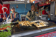 Sellers of sandwiches fish at Istanbul. Sellers of fresh fish to Galata bridge at Istanbul in Turkey stock photo