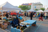 Sellers of second hand items laid out goods on the market. Sellers of second hand items laid out goods in the early morning on the famous market Naschmarkt. The Stock Images