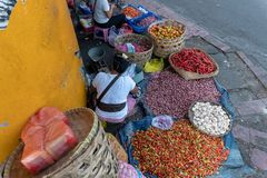 Sellers of spices such as red chili, red onion and garlic are selling their trade in one corner of the traditional Badung market stock photography