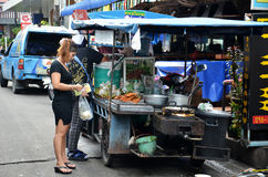 The sellers of street food stalls in the city stock photo