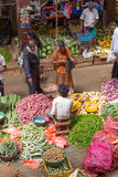 Sellers in street market sell fresh fruits and vegetable in Sri Lanka Royalty Free Stock Photo