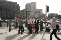 Sellers at tahrir square in Cairo, Egypt. People in tahrir square, selling Egyptian flags in Cairo, Egypt post revolution time Stock Images