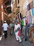 Sellers in textile souk in Bur Dubai. Shop salesmen in the ancient covered textile souq Bur Dubai in the old city centre of Dubai, United Arab Emirates Stock Images