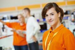 Selles assistant. Positive seller or shop assistant portrait  in supermarket store Stock Photos