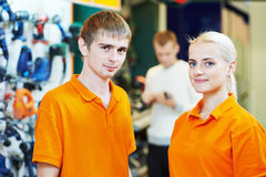 Selles assistant. Positive team of sellers or shop assistant group portrait  in supermarket store Stock Images