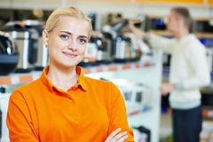 Selles assistant in shop. Positive seller or shop assistant portrait  in supermarket store Royalty Free Stock Image
