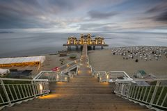 Sellin, Rugen island, Germany-July 2015: Stylish wooden pier fro Stock Photos