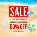 Selling ad banner, vintage text design. Fifty percent summer vacation discounts, sale background of the sandy beach and Royalty Free Stock Images
