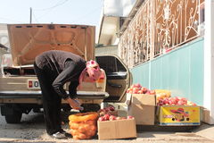 Selling apples in the streets, Kyrgyzstan Royalty Free Stock Photos