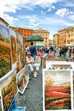Selling art to tourists in the Piazza Navona of Rome, Italy. Royalty Free Stock Images