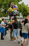 Selling balloons. Bristol, UK - July 16, 2016: a man selling  balloons in The 45th Harbour Festival in Bristol, UK Stock Photos