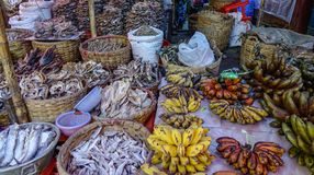 Selling banana with dry fish royalty free stock images