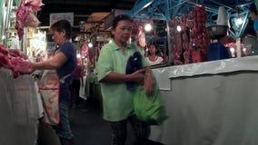 Selling beef in flea market stalls woman slicing meat
