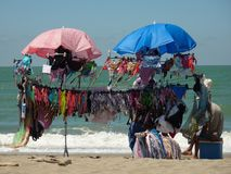 Selling bikinis on the Italian beach. Mostly exploited by African immigrants royalty free stock photos