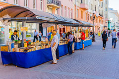 Selling books in Arbat street of Moscow. Vakhtangov Theatre and fountain Turandot in Arbat street of Moscow, Russia, on Sunday, July 13, 2014. Arbat is a Royalty Free Stock Photos
