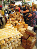 Selling bread. A woman selling all different kinds of bread at the famous Borough market. London, 2011 Royalty Free Stock Image