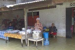 Selling breakfast in a floody morning Royalty Free Stock Photography