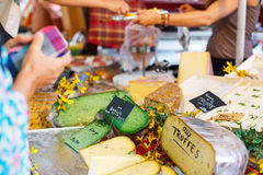 Selling and buying cheese  on market place in Provence, France. Hands of a seller Royalty Free Stock Images