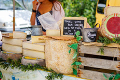 Selling and buying cheese  on market place in Provence, France. Hands of a seller Stock Image