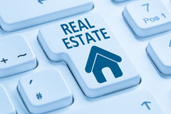 Selling buying real estate home icon online blue computer keyboa Stock Image