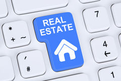 Selling or buying a real estate home icon online on the computer. Selling or buying a real estate investment home icon online on the computer Stock Photo