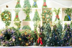 Selling Christmas wreaths in the town festival fair. Christmas gift booth.  stock photo