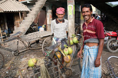 Selling a coconut on  market Royalty Free Stock Photography