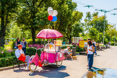 Selling cotton candy, candyfloss, in Moscow Gorky park. Moscow, Russia. 12th July 2014: Selling cotton candy, candyfloss, in Moscow Gorky park on a sunny summer Royalty Free Stock Photography
