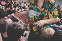 Selling  drinks in crowded park Royalty Free Stock Images