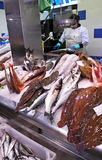 Selling fish in the market fishmonger, Spain Royalty Free Stock Photo