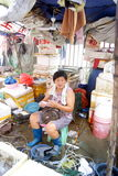 Selling fish in the seafood market of middle-aged women. In July 1st, 2013, Shenzhen Xixiang seafood market, a middle-aged woman selling fish stock image