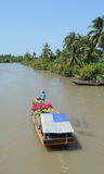 Selling flowers on boat in Mekong Delta, southern Vietnam Stock Image