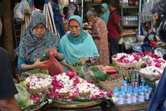 Selling Flowers at market. Residents buy flowers at Peterongan Market Semarang, Thursday June 14, 2018. The most delicious night flowers hunted by buyers of royalty free stock photos