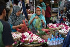 Selling Flowers at market. Residents buy flowers at Peterongan Market Semarang, Thursday June 14, 2018. The most delicious night flowers hunted by buyers of stock images