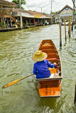 Selling food on a boat at floating market, Thailand Royalty Free Stock Images
