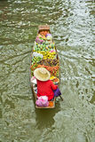 Selling food on a boat at floating market, Thailand Stock Photo