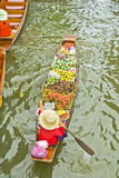 Selling food on a boat at floating market, Thailand Royalty Free Stock Photos