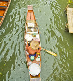 Selling food on a boat at floating market, Thailand Royalty Free Stock Photography