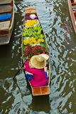 Selling food on a boat at floating market, Thailand Royalty Free Stock Photo