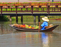Selling food on a boat at floating market, Thailand Stock Image