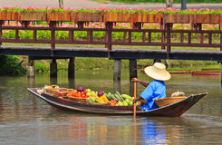 Selling food on a boat at floating market, Thailand Stock Images