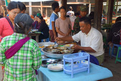 Selling food on  Inle Lake Royalty Free Stock Photography