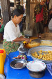 Selling food on  Inle Lake Stock Photo