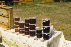Selling fresh honey around the apiary Stock Photography