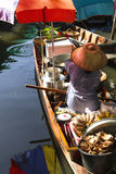 Selling fried banana on Bangkok floating market, Thailand Stock Photos