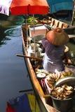 Selling fried banana on Bangkok floating market, Thailand Stock Photos