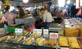 Selling Fried Fish and Fish Sausages Stock Photos