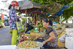 Selling fruit and vegetable at the market Royalty Free Stock Photography